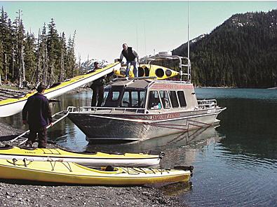 WhittierExpress loading kayaks on board
